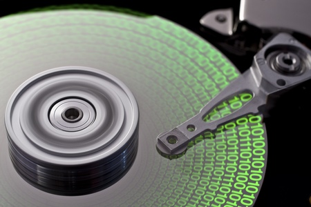 fixed disk: studio photography of a opened hard disk with symbolic data Stock Photo