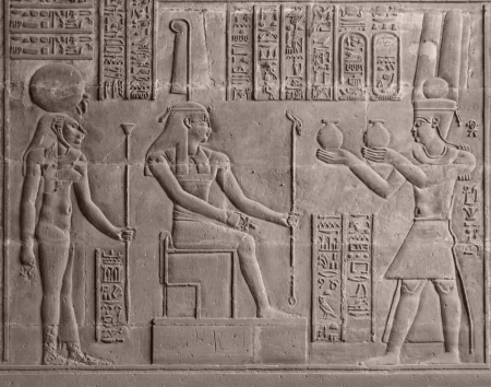 ancient stone relief at Chnum temple in Egypt photo
