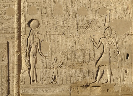 allegory painting: architectural detail of the historic Esana temple in Egypt (Africa) showing a stone-carved  relief and lots of hieroglyphics