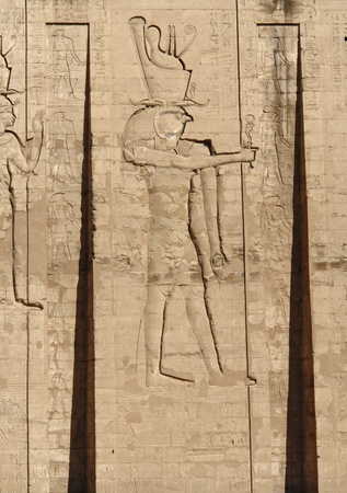 stone wall with relief at the ancient Temple of Edfu in Egypt (Africa) photo
