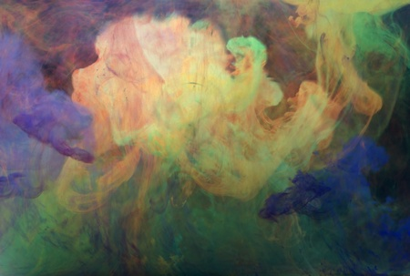 disintegration: photography showing floating color clouds in underwater ambiance