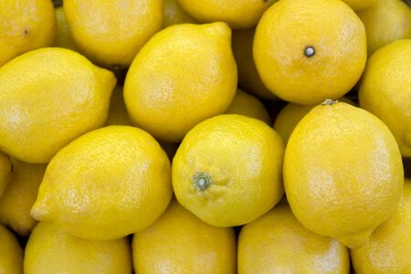 citrons: full frame background with lots of fresh yellow citrons