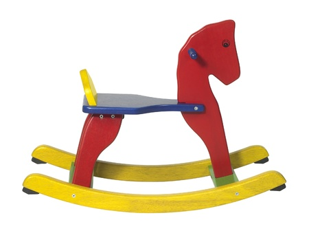 studio photography of a colorful wooden rocking horse in white back photo