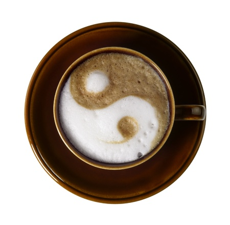 cup of coffee with marbled milk froth, isolated on white with clipping path, seen from above photo