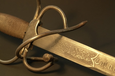 mediaeval: studio photography showing a rusty sword with decorative ornaments Stock Photo