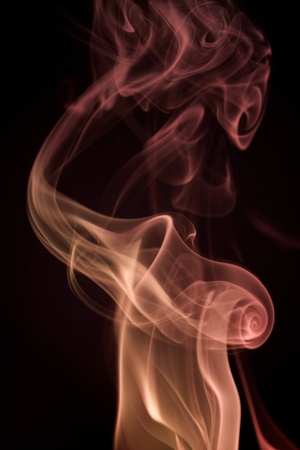 wavily: abstrackt background showing some colorful smoke in black back