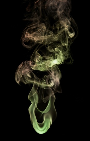 particulates: abstract picture showing some colored smoke in black background Stock Photo