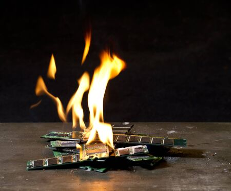 small pile of burning RAM sticks in front of dark back Stock Photo - 10862583