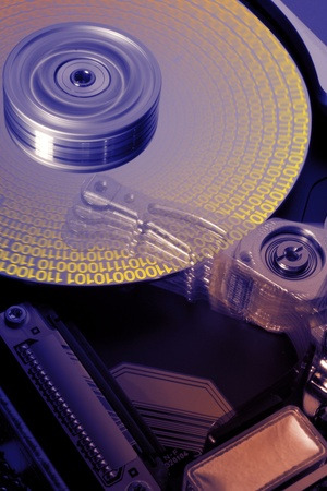 studio photography of a opened hard disk at work with symbolic data while processing photo