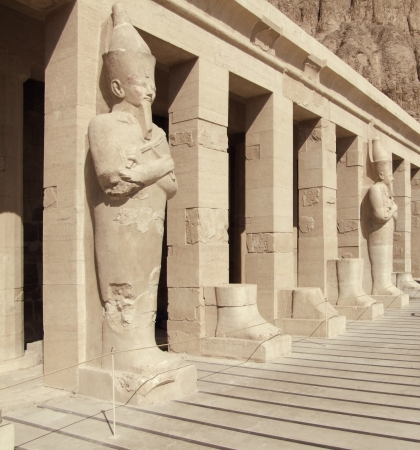 ancient stone sculptures in Deir el-Bahri in Egypt in sunny ambiance photo