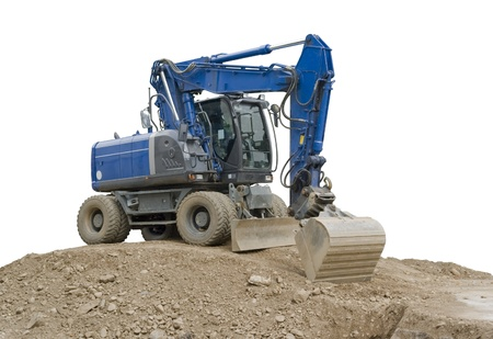 a blue digger resting on a earth pile, outdoor shot in white back photo