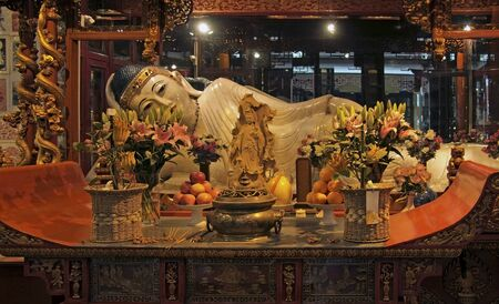 jade buddha temple: old reclining Budda statue inside the Jade Buddha Temple in Shanghai (China) Editorial