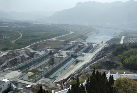 made in china: foggy aerial view of the Three Gorges Dam at Yangtze River in China