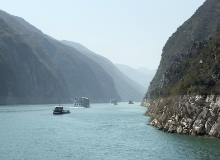 yangtze river: foggy scenery along the Yangtze River in China including some ships and mountains
