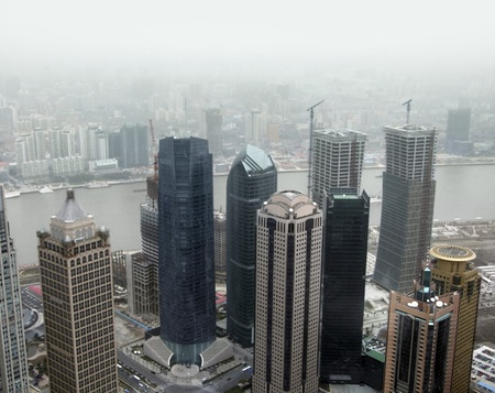 aerial city view showing the skyline of Pudong, a district of Shanghai in China photo