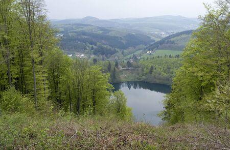 idyllic scenery showing a maar in the Vulkan Eifel, wich is a region in the Eifel Mountains in Germany Stock Photo - 10863162