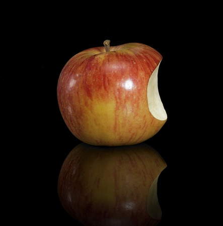macintosh: apple with missing part in black reflective back. Looks a little bit like the Apple Macintosh Logo