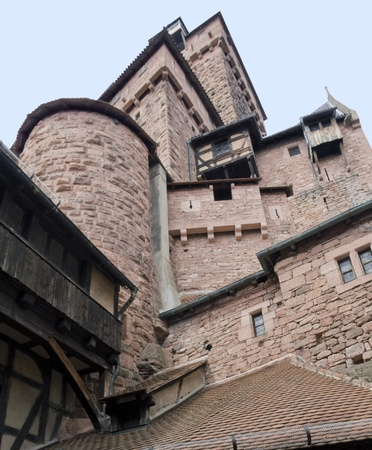 low angle detail of the Haut-Koenigsbourg Castle, a historic castle located in a area named Alsace in France photo