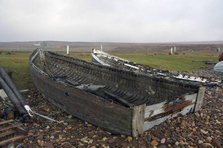 coastal landscape with rotten boats in Scotland photo