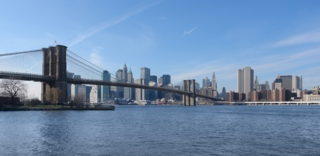 city view of New York (USA) with Brooklyn Bridge and East River in sunny ambiance photo