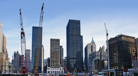 urbanized: city view of New York (USA) showing a big construction site surrounded by skyscrapers at Ground Zero