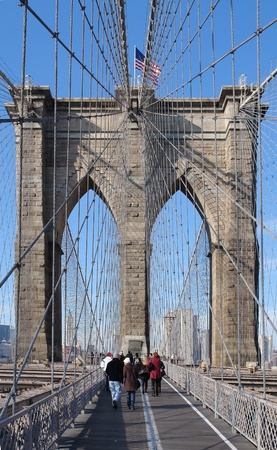 urbanized: city view of New York (USA) while walking on the Brooklyn Bridge in sunny ambiance Editorial