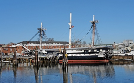 anchoring: sailing ship named USS Constitution anchoring in Boston (Massachusetts, USA) at winter time in sunny ambiance Stock Photo