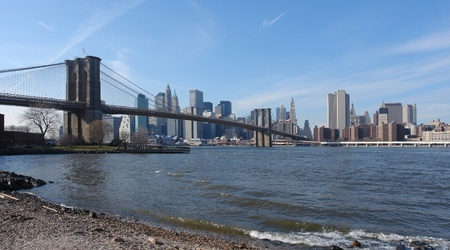 city view of New York with Brooklyn Bridge and East River (USA) in sunny ambiance Stock Photo - 10967340