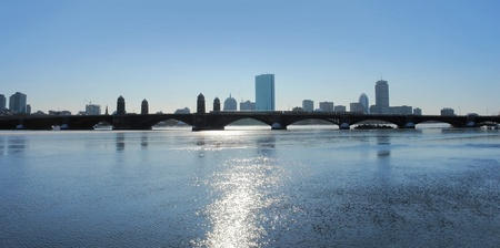 steel arch bridge: panoramic scenery including the skyline of Boston (Massachusetts, USA) in sunny ambiance at evening time