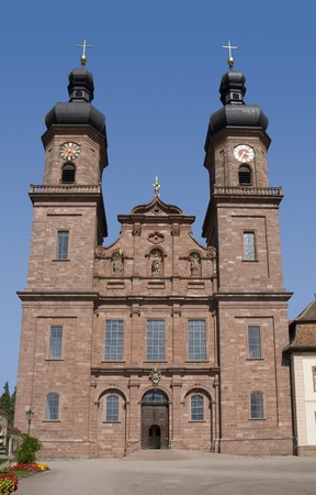 frontal shot of the Abbey of Saint Peter in the Black Forest at summer time in sunny ambiance photo