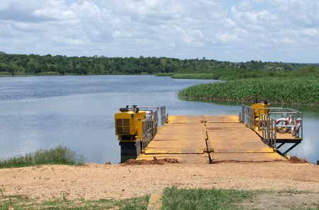 white nile: a ferry pier at the White Nile in Uganda (Africa) in sunny ambiance
