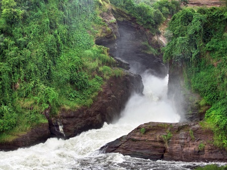 rock formation: detail of the Murchison Falls with green overgrown rock formation in Uganda (Africa)