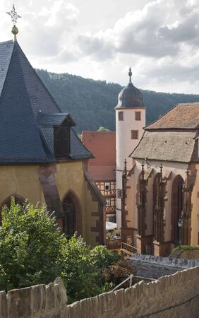 wertheim: detail of the Kilianskapelle and Stiftskirche in the Old Town of Wertheim am Main (Southern Germany) at summer time in sunny ambiance Stock Photo