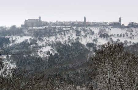 idyllic winter scenery including Waldenburg, a small city in Hohenlohe located in Southern Germany photo
