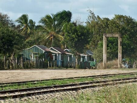 poor wooden cabins near railroad track at the Dominican Republic, a island of Hispanola wich is a part of the Greater Antilles archipelago in the Carribean region photo