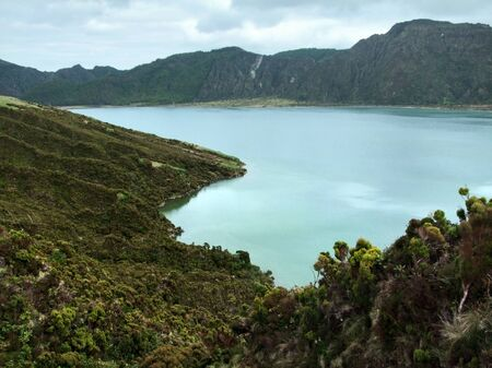 rocky overgrown lakeside scenery at Sao Miguel Island photo