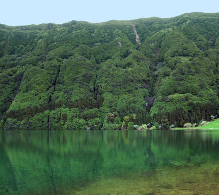 agriculture azores: translucent lake and overgrown hills at Sao Miguel Island