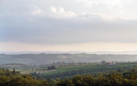 idyllic scenery near a small village named San Regolo in the Chianti region (Tuscany, Italy) at evening time photo