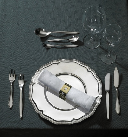 classy place setting with flatware and drinking glasses seen from above photo