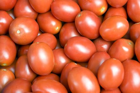 full frame background with lots of fresh red tomatoes photo