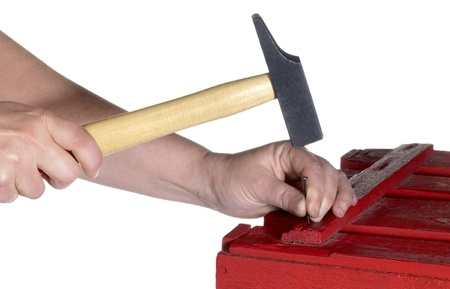 hammering: a hammering hand in white back