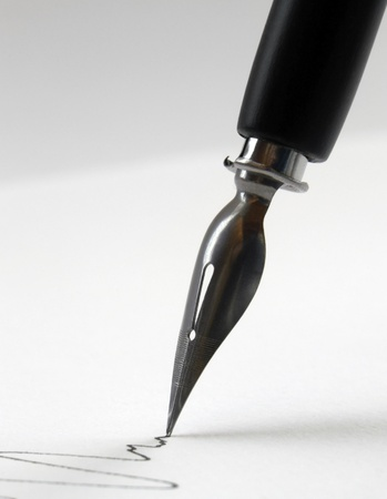 detail of a nib tip while drawing a line in light back photo