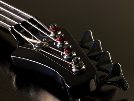 worm gear: detail of a bass guitar in dark back