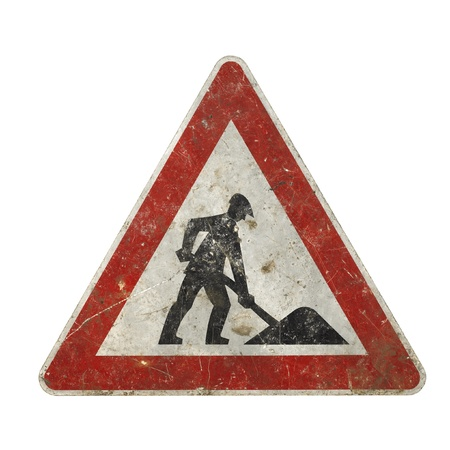 frontal studio photography of a old scruffy construction sign showing a working man in white back photo