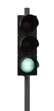 green traffic light isolated on white photo