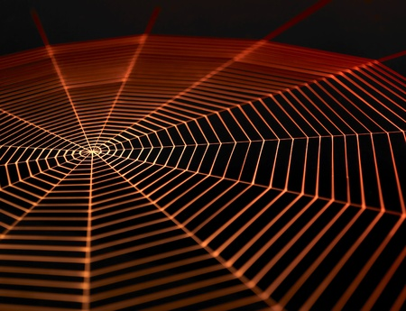 full frame symbolic picture with a painted spiderweb in dark back, orange illuminated Stock Photo