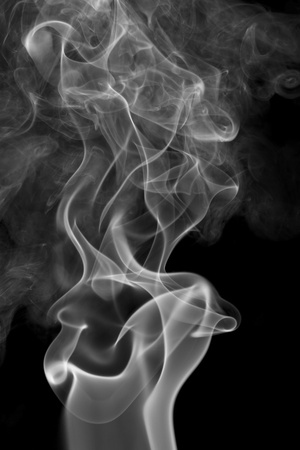 particulates: abstract picture showing some smoke in dark back