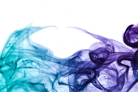 particulates: abstract picture showing some multicolored smoke in white back