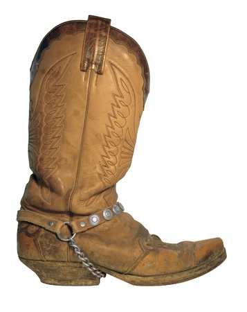 'hide out': old used cowboy boot with chain Stock Photo