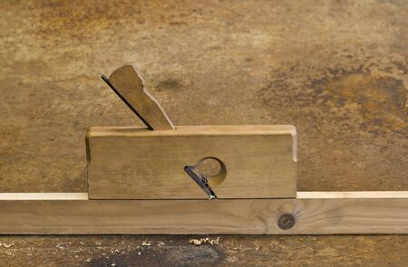 planer: old planer on wooden plank Stock Photo